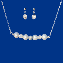 Load image into Gallery viewer, handmade crystal and pearl bar necklace accompanied by a pair of crystal stud earrings