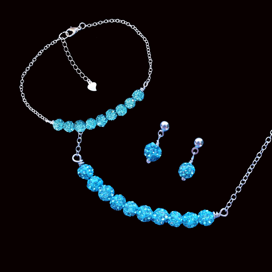 handmade crystal bar necklace accompanied by a matching bracelet and a pair of stud earrings