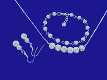 Load image into Gallery viewer, A handmade crystal bar necklace accompanied by a bracelet and a pair of drop earrings.