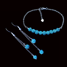 Load image into Gallery viewer, handmade crystal bar bracelet accompanied by a pair of multi-strand drop earrings