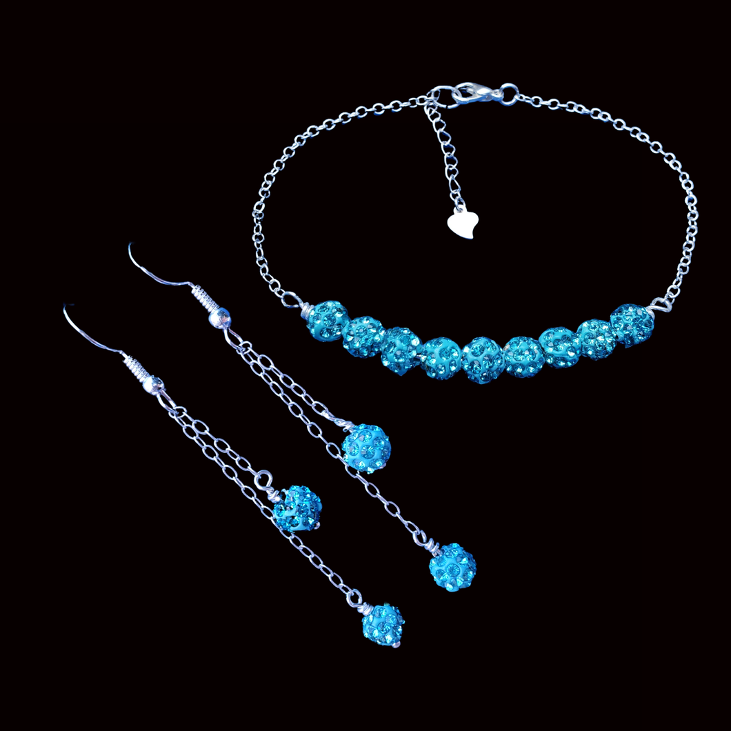 handmade crystal bar bracelet accompanied by a pair of multi-strand drop earrings