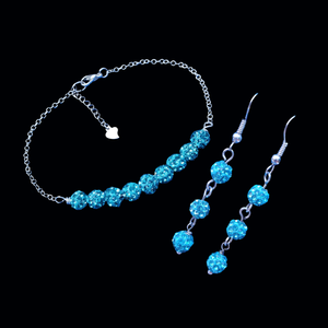 handmade crystal bracelet accompanied by a pair of drop earrings