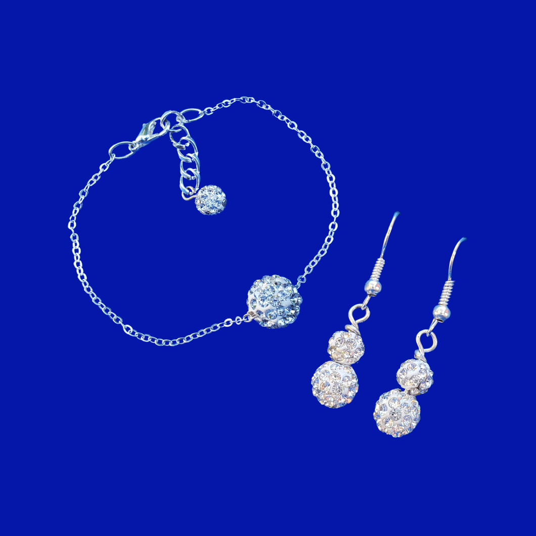 handmade floating crystal bracelet accompanied by a pair of drop earrings