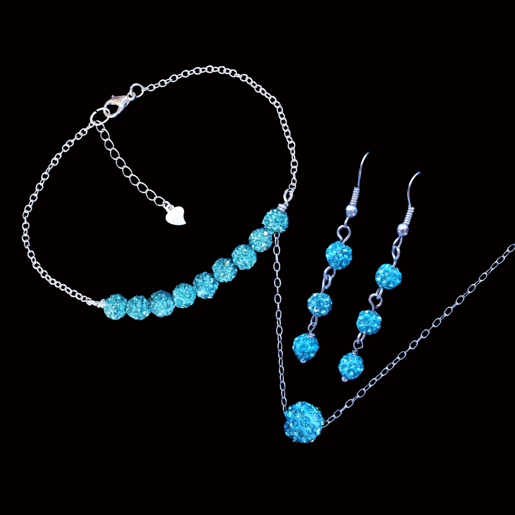 handmade crystal floating necklace is accompanied by a bracelet and a pair of drop earrings