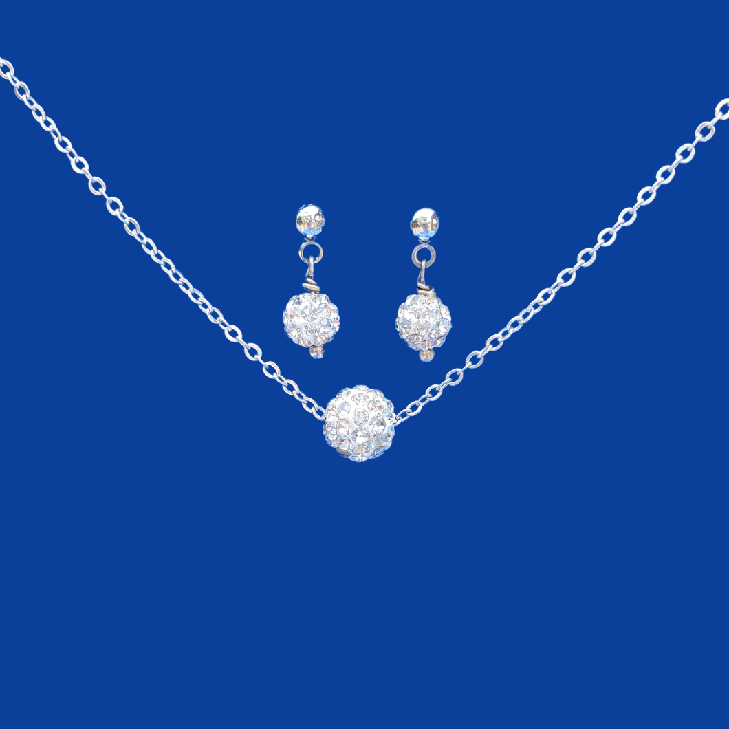 A handmade floating crystal necklace accompanied by a pair of stud earrings.