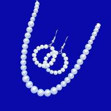 Load image into Gallery viewer, handmade pearl necklace accompanied by a pair of hoop earrings