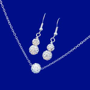 A handmade floating crystal necklace accompanied by a pair of drop earrings.