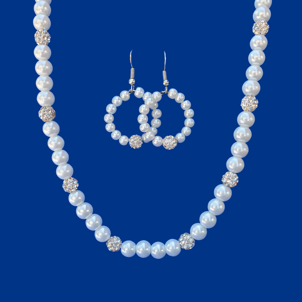handmade pearl and crystal necklace accompanied by a pair of hoop earrings