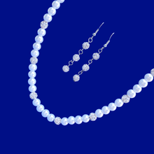 Load image into Gallery viewer, handmade pearl and crystal necklace accompanied by a pair of crystal drop earrings