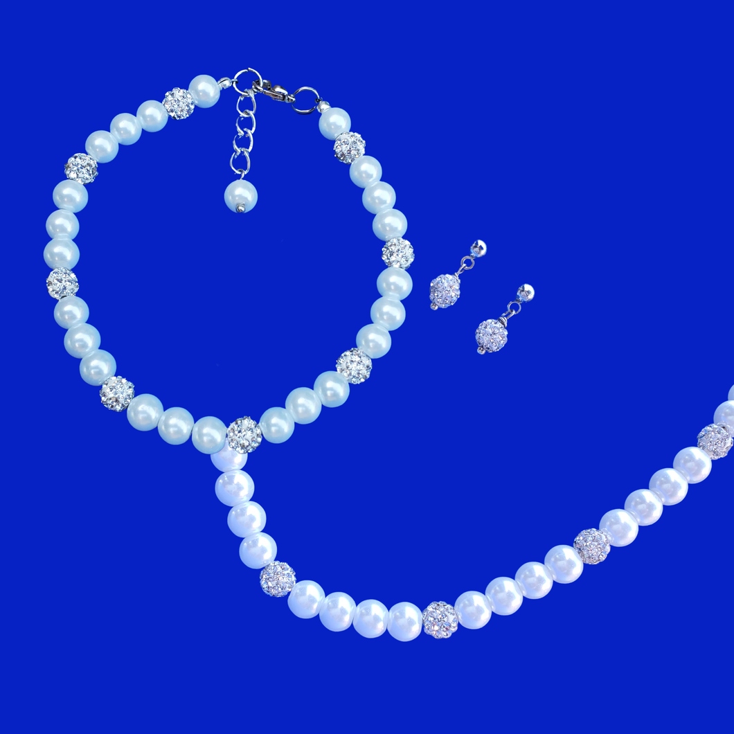 handmade pearl and crystal necklace accompanied by a matching bracelet and a pair of crystal stud earrings