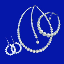 Load image into Gallery viewer, handmade pearl necklace with a 6 inch backdrop accompanied by a matching bracelet and a pair of hoop earrings