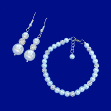 Load image into Gallery viewer, a handmade pearl and crystal bracelet accompanied by a pair of drop earrings