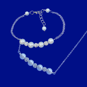 handmade pearl and pave crystal rhinestone bar necklace accompanied by a matching bracelet