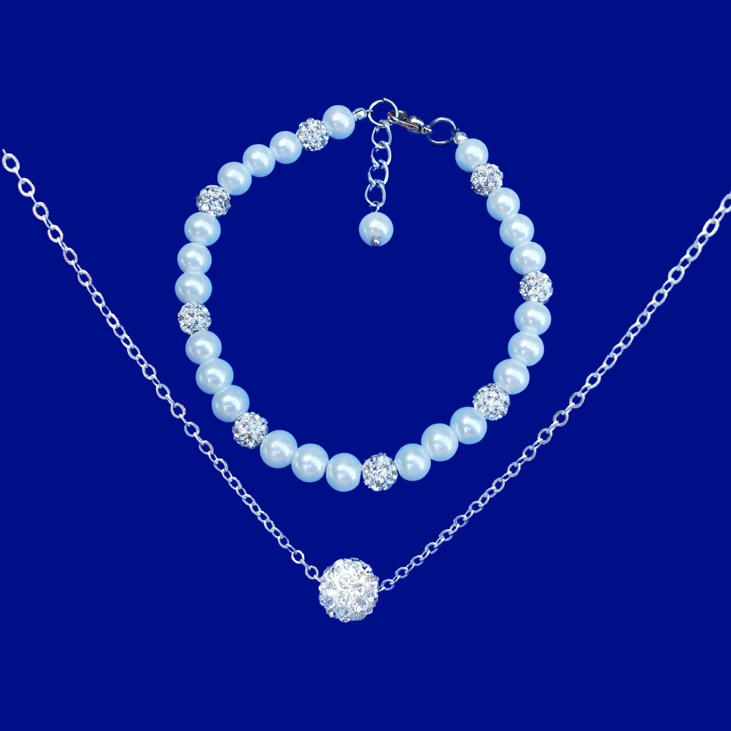handmade floating crystal necklace accompanied by a pearl and crystal bracelet