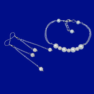 handmade pearl and crystal bar bracelet accompanied by a pair of multi-strand drop earrings