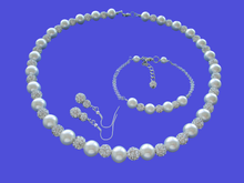 Load image into Gallery viewer, A handmade pearl and crystal necklace accompanied by a bar bracelet and a pair of crystal drop earrings.