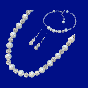 A handmade pearl and crystal necklace accompanied by a bar bracelet and a pair of crystal drop earrings.