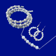 Load image into Gallery viewer, handmade pearl and crystal bar necklace accompanied by a multi-layer, expandable, wrap bracelet and a pair of hoop earrings