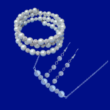 Load image into Gallery viewer, A handmade pearl and crystal bar necklace accompanied by an expandable, multi-layer, wrap bracelet and a pair of crystal drop earrings.