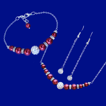 Load image into Gallery viewer, A handmade pearl and crystal bar necklace accompanied by a matching bar bracelet and a pair of crystal drop earrings.