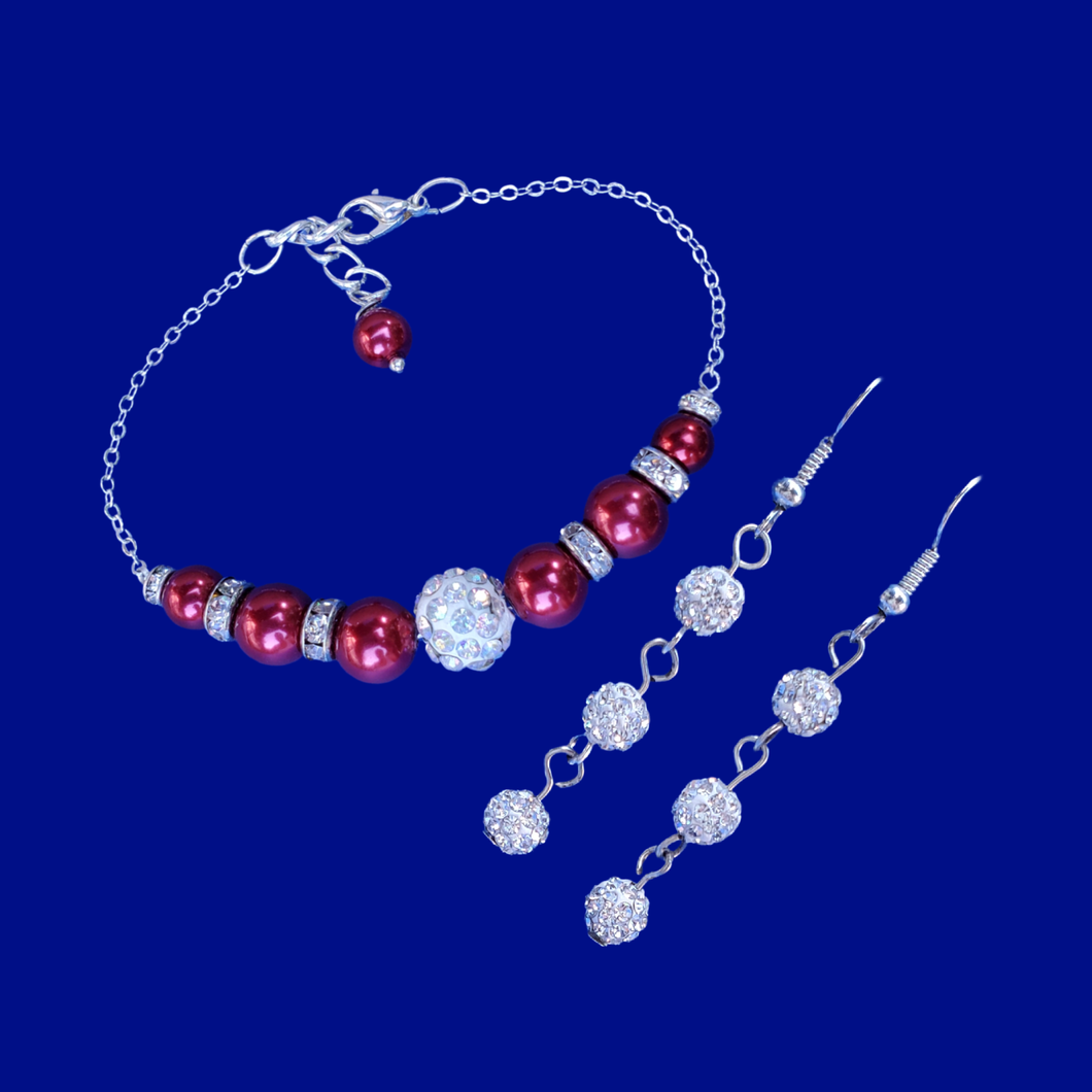 handmade pearl and crystal bar bracelet accompanied by a pair of crystal drop earrings