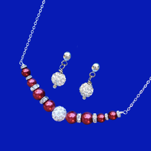 Load image into Gallery viewer, handmade pearl and crystal bar necklace accompanied by a pair of crystal stud earrings