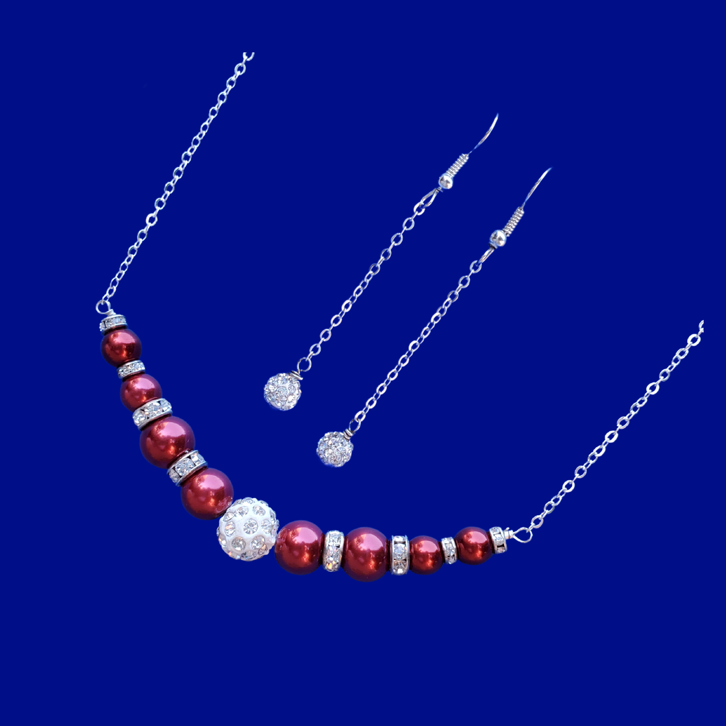 handmade pearl and crystal bar necklace accompanied by a pair of crystal drop earrings