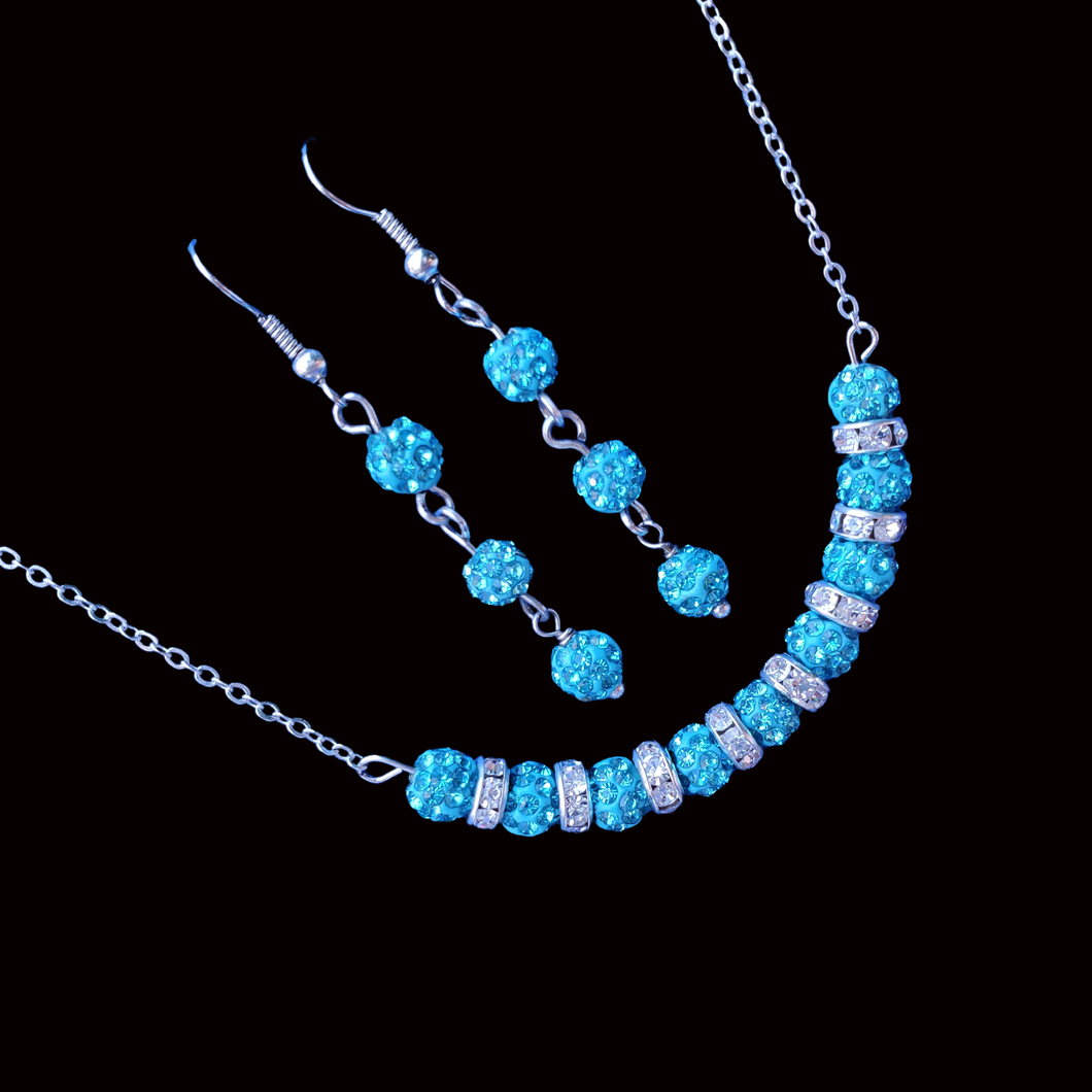 crystal bar necklace accompanied by a pair of drop earrings