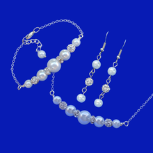 Load image into Gallery viewer, handmade pearl and crystal bar necklace accompanied by a matching bar bracelet and drop earrings