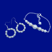 Load image into Gallery viewer, handmade pearl and crystal bar bracelet accompanied by a pair of hoop earrings