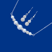 Load image into Gallery viewer, handmade pearl and crystal bar necklace accompanied by a pair of crystal earrings