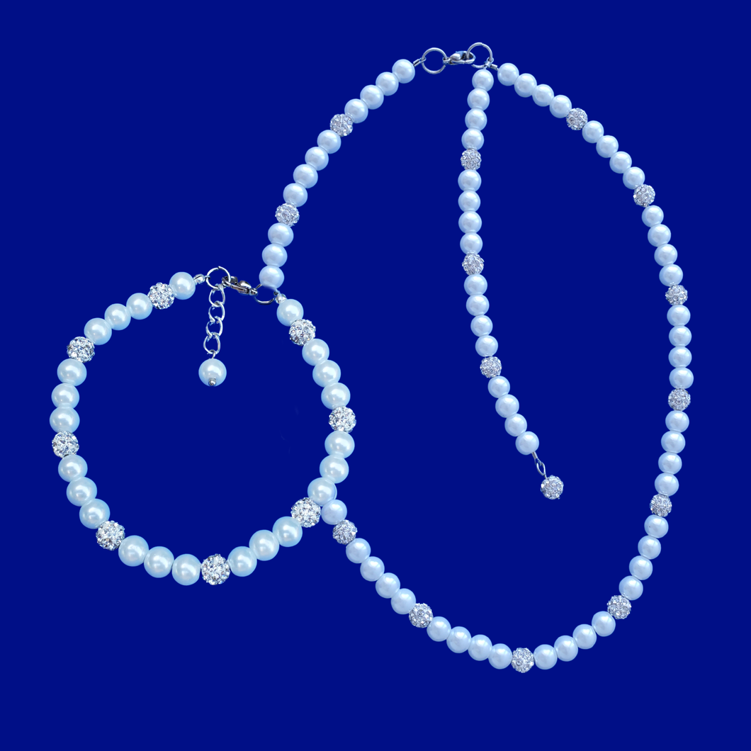 handmade pearl and crystal necklace with or without a 5 inch backdrop is accompanied by a matching bracelet