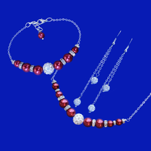 Load image into Gallery viewer, handmade pearl and crystal bar necklace accompanied by a matching bracelet and a pair of multi-strand crystal drop earrings