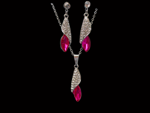 A crystal teardrop drop necklace accompanied by a pair of matching earrings.