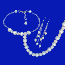 Load image into Gallery viewer, handmade pearl and crystal necklace accompanied by a bar bracelet and a pair of multi-strand drop earrings