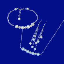 Load image into Gallery viewer, handmade peal and crystal bar necklace accompanied by a matching bracelet and a pair of multi-strand drop earrings