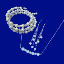 Load image into Gallery viewer, handmade pearl and crystal bar necklace accompanied by an expandable, multi-layer, wrap bracelet and a pair of multi-strand drop earrings