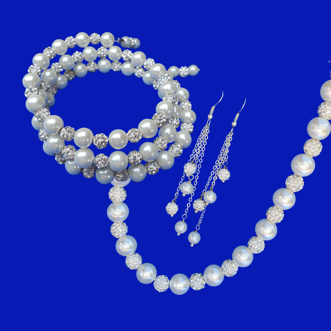 handmade pearl and crystal necklace accompanied by an expandable, multi-layer, wrap bracelet and a pair of multi-strand drop earrings