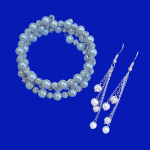 A handmade pearl and crystal expandable, multi-layer, wrap bracelet accompanied by a pair of multi-strand drop earrings.