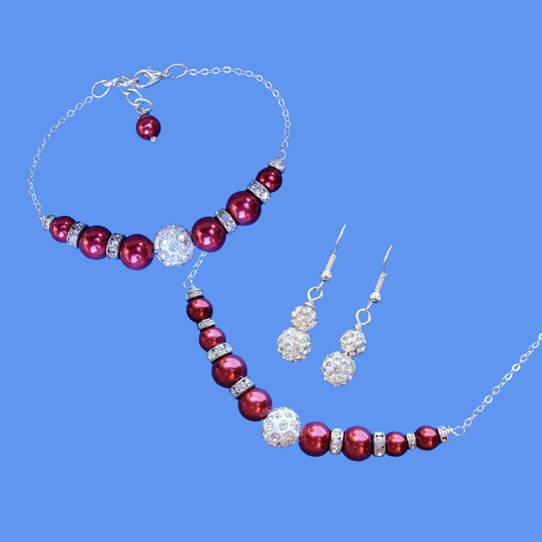 andmade pearl and crystal bar necklace accompanied by a matching bracelet and a pair of crystal drop earrings