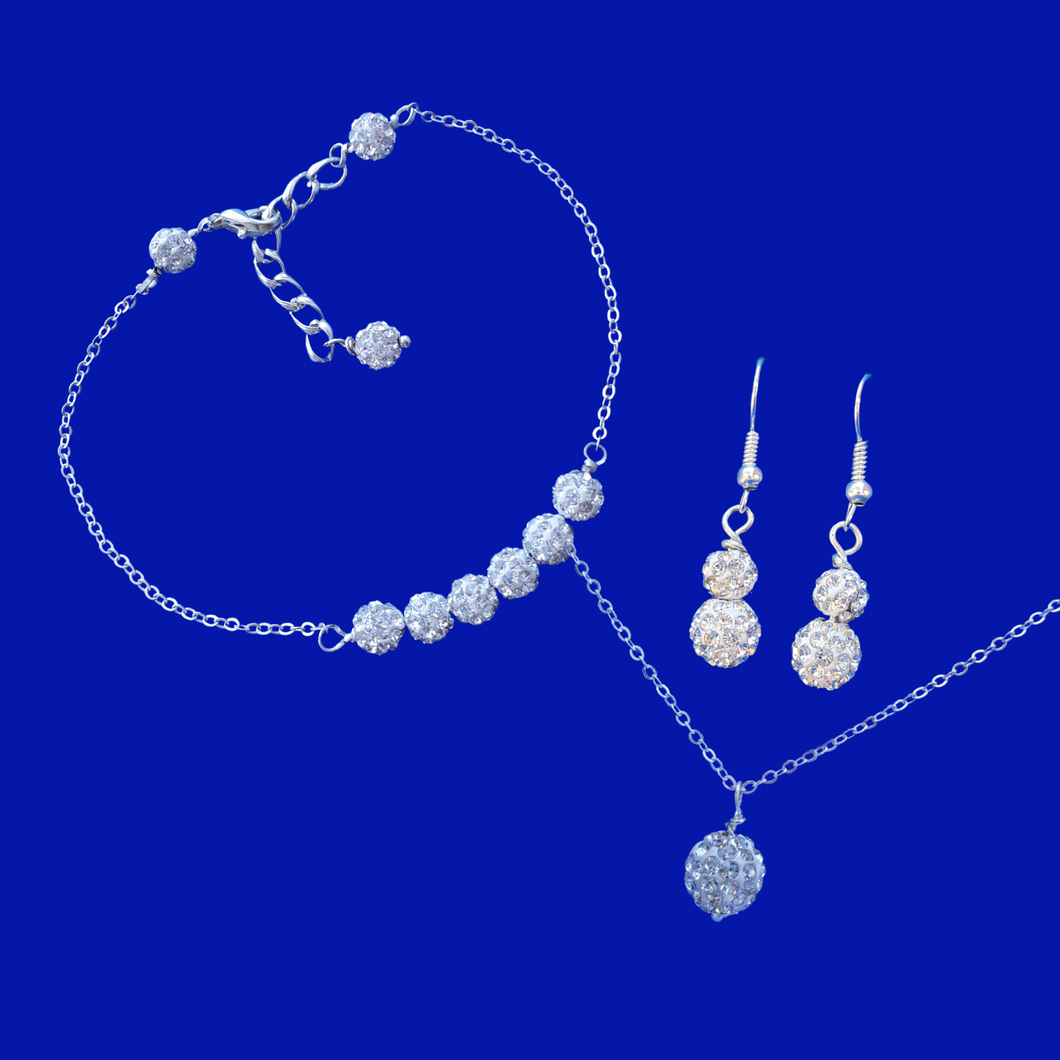handmade crystal drop necklace accompanied by a bar bracelet and a pair of drop earrings, silver clear