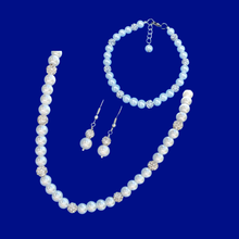 Load image into Gallery viewer, handmade pearl and crystal necklace accompanied by a matching bracelet and drop earrings