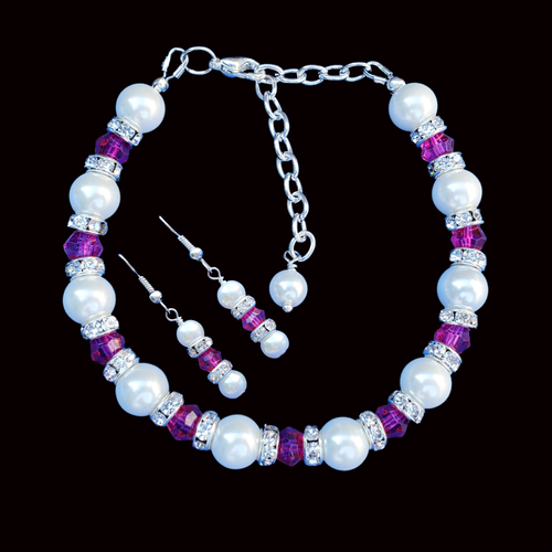 handmade pearl and swarovski crystal bracelet accompanied by a pair of drop earrings