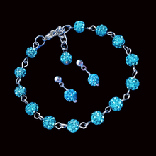 Load image into Gallery viewer,  handmade crystal bracelet accompanied by a pair of stud earrings