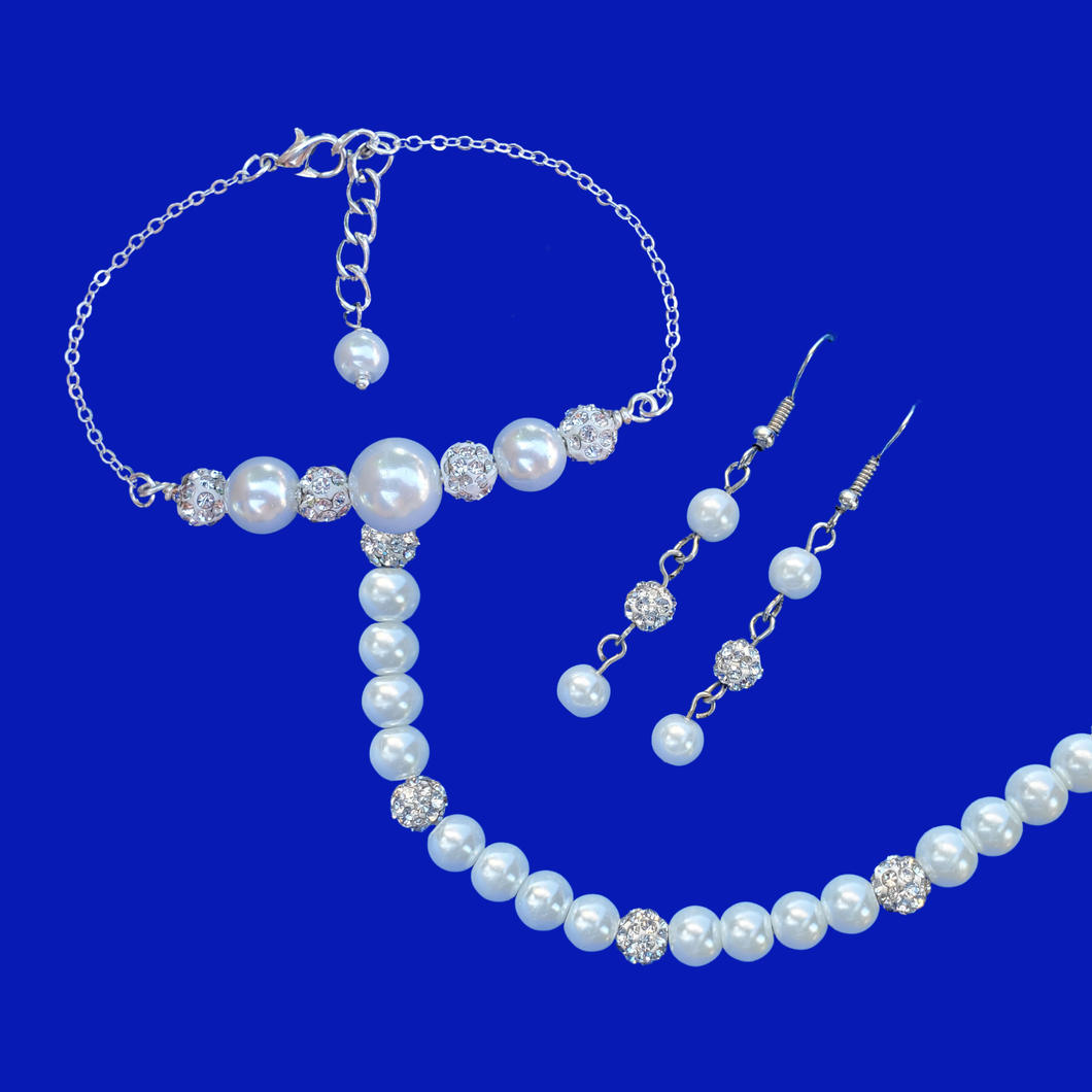 handmade pearl and crystal necklace accompanied by a bar bracelet and a pair of matching drop earrings