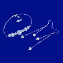 Load image into Gallery viewer, pearl and crystal bar bracelet and a matching pair of multi-strand crystal drop earrings
