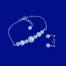 Load image into Gallery viewer, handmade pearl and crystal bar bracelet accompanied by a pair of crystal stud earrings
