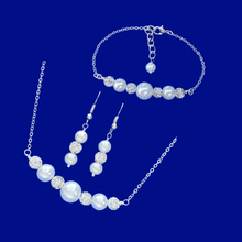 Load image into Gallery viewer, handmade pearl and crystal bar necklace accompanied by a bar bracelet and a matching pair of drop earrings
