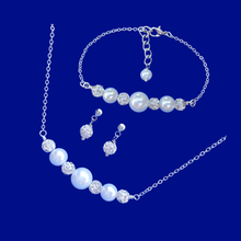 Load image into Gallery viewer, handmade pearl and crystal bar necklace accompanied by a matching bar bracelet and a pair of crystal stud earrings