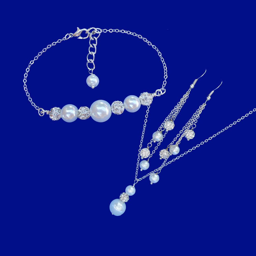 handmade pearl and crystal drop necklace accompanied by a bar bracelet and a pair of multi-strand drop earrings